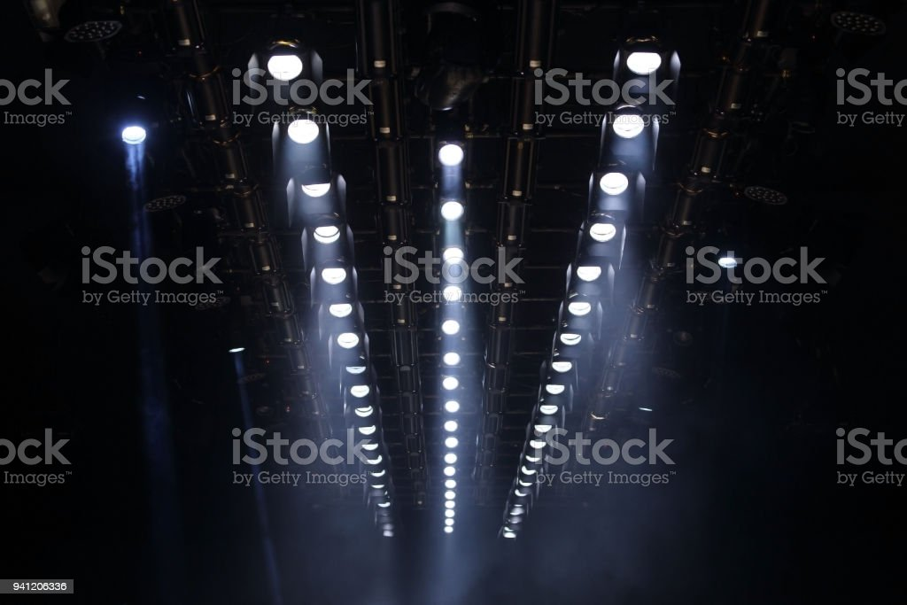 Lights beams Spotlight ray moving lighting on rack construction ceiling stock photo