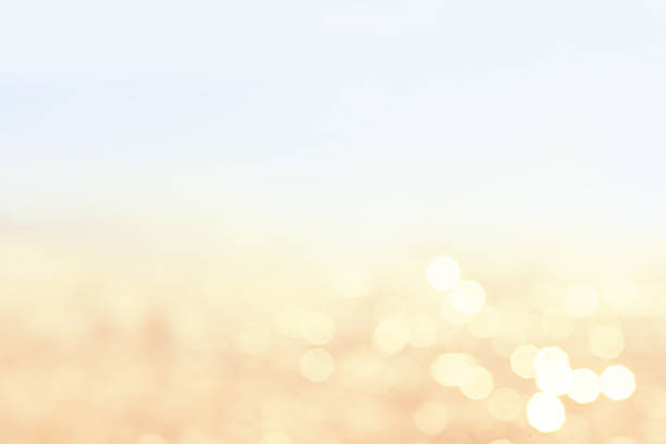 Lights blurred bokeh background in sunny summer day stock photo