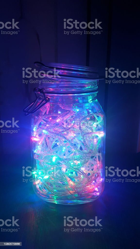 Holiday and perennial white and multicolored LED lights glowing from...