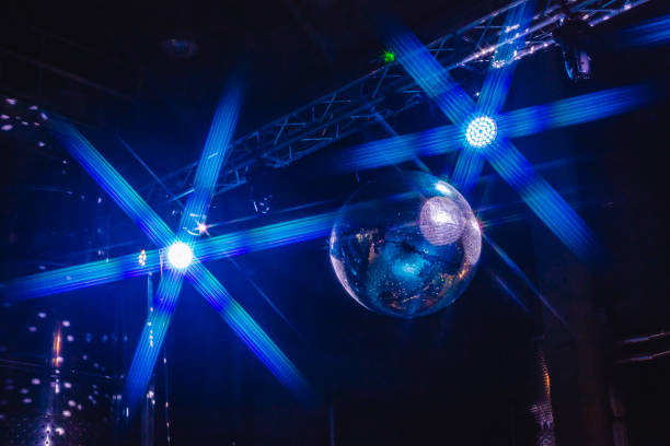 Lights Effect Disco Ball Blue background disco ball with disco lights. prom night stock pictures, royalty-free photos & images