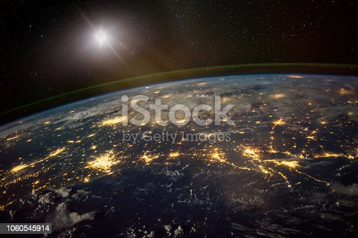 istock Lights from areas in the Gulf Coast states of Texas, Louisiana, Mississippi and Alabama, satellite view, The elements of this image furnished by NASA. 1060545914