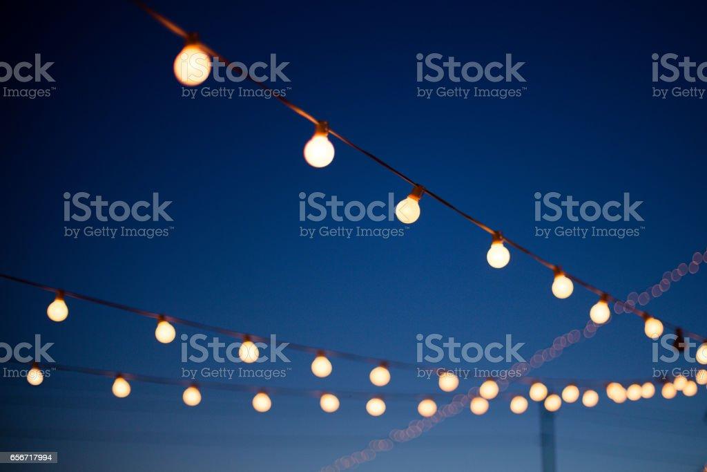 Lights hang outdoors stock photo
