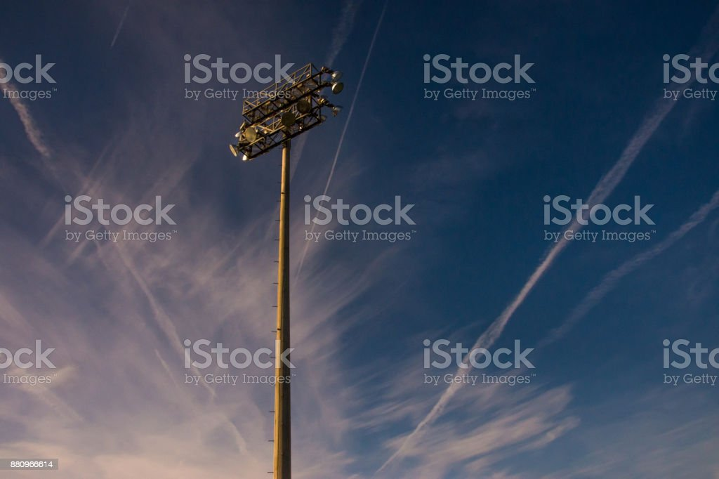 Lights in a burst of contrails and clouds stock photo