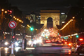 Speed of lights in Paris with triumphal arch in background