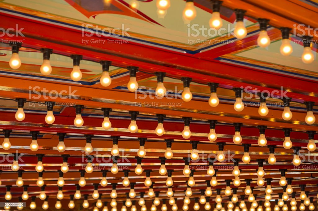 Lights of a carousel at vintage amusement park stock photo
