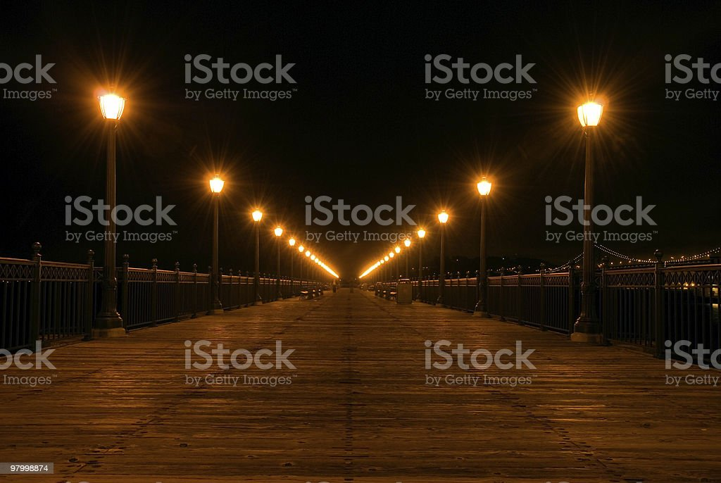 Lights of a pier/walkway at night royalty free stockfoto