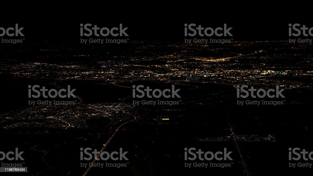 Lights Of Houses And Roads Of Amsterdam City Top View From Airplane Window At Night Stock Photo Download Image Now Istock