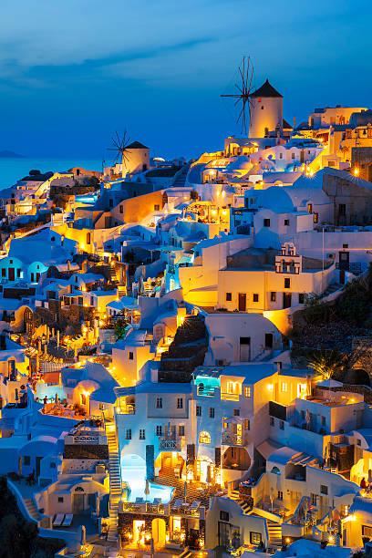 lights of oia village at night - oia santorini bildbanksfoton och bilder