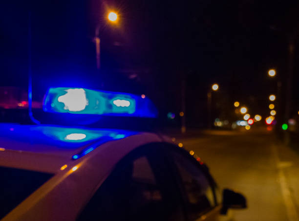 Lights of police car in night time. Night patrolling the city. Abstract blurry image. stock photo