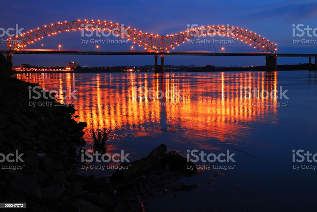 Lights of the De Soto Bridge in Memphis Reflect in the Mississippi River stock photo