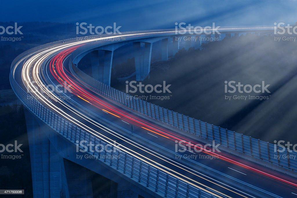Lights of vehicles in moonlight stock photo