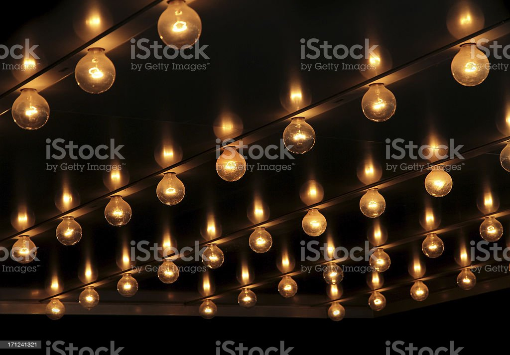 Lights under theatre marquee sign. stock photo