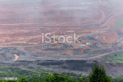 istock Lignite and Coal mine field pit nature mountain destruction 1180186215