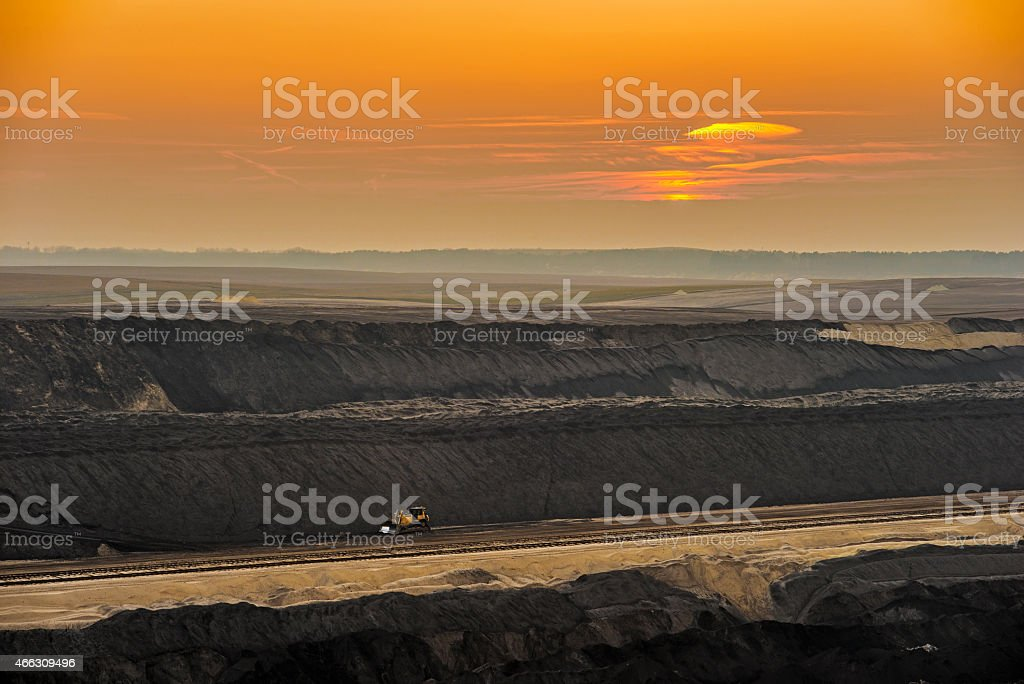 Lignite mining - destroyed landscape in the sunset stock photo