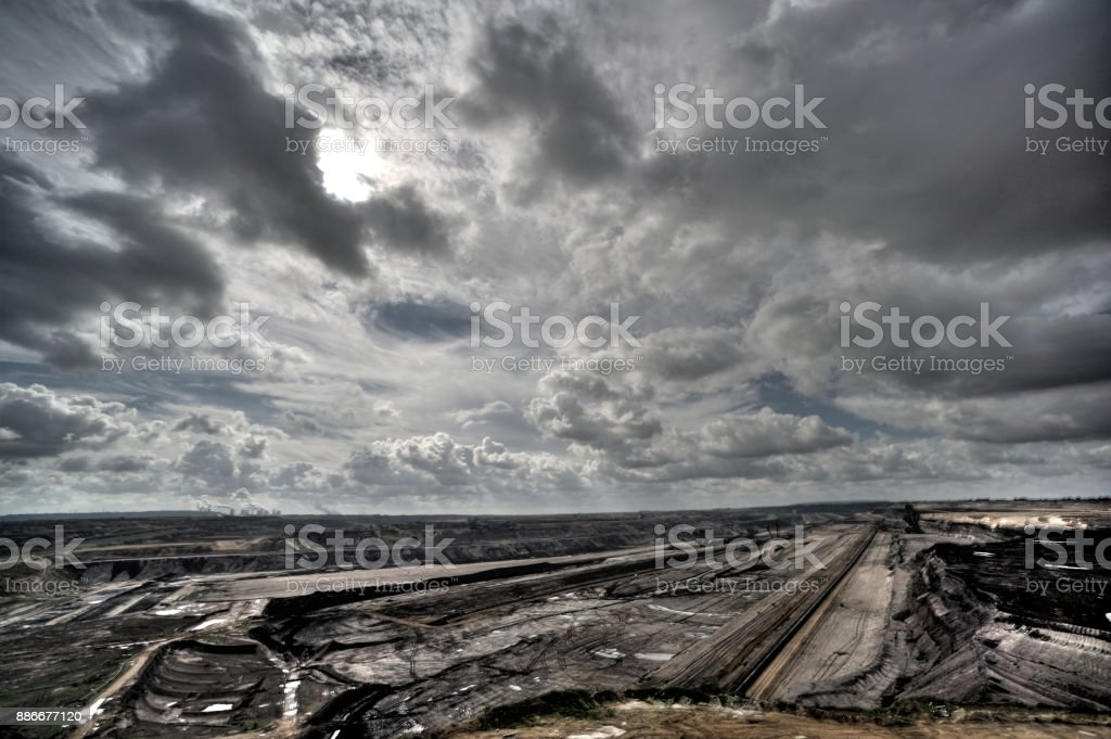 Lignite-fired power plants behind a brown coal mine with dramatic clouds and emissions stock photo