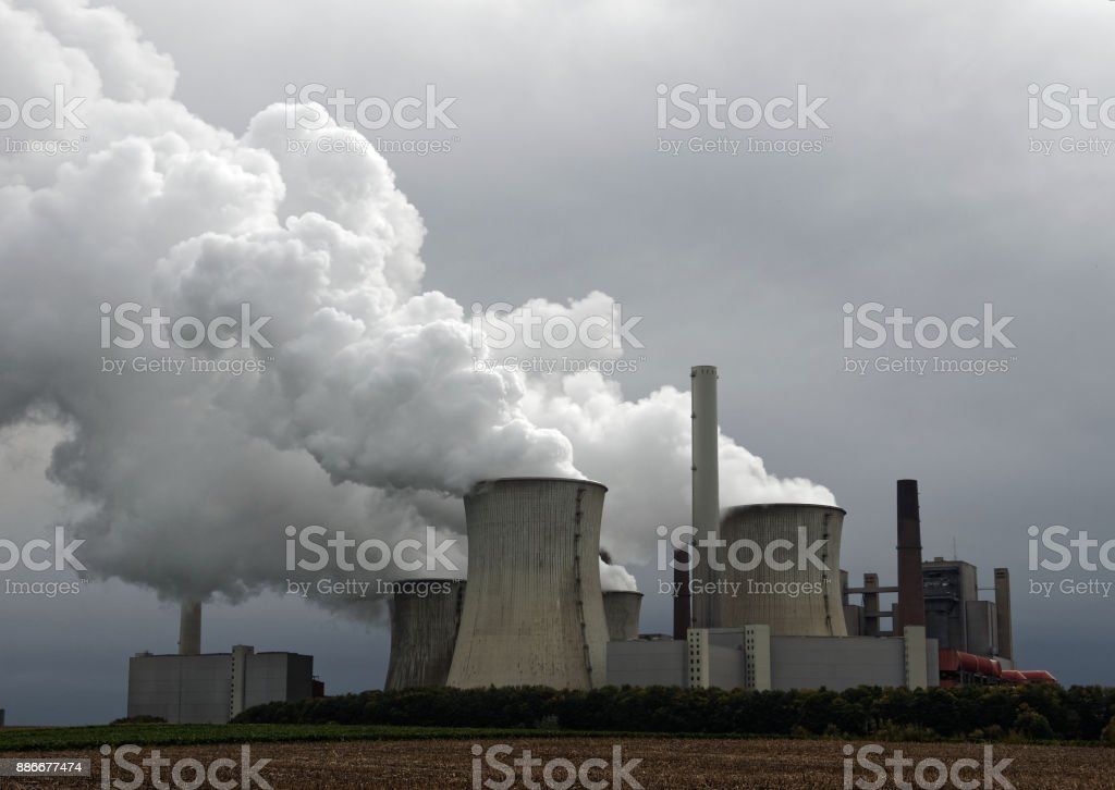 Lignite-fired power plants for power generation, emissions and dramatic clouds stock photo