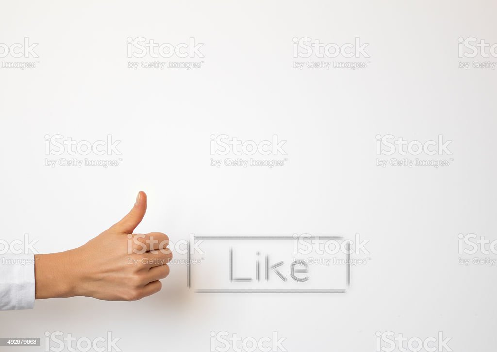 Like button and hand showing thumb up gesture royalty-free stock photo