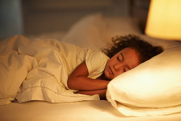 I like mom's bed the best A cute little girl fast asleep in a double bed bedtime stock pictures, royalty-free photos & images