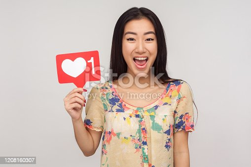 640248524 istock photo Like social media content! Delighted enthusiastic girl in blouse showing internet heart icon, recommending to subscribe 1208160307