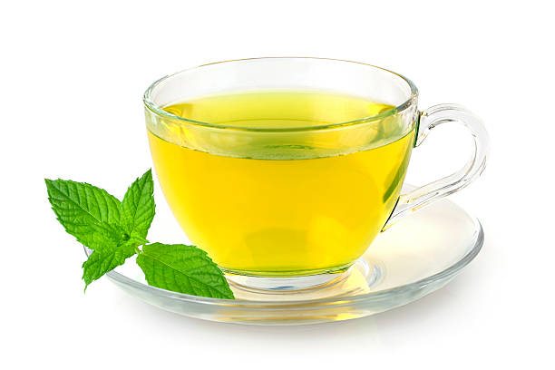 Mint tea A glass cup of fresh mint tea on white background greentea stock pictures, royalty-free photos & images