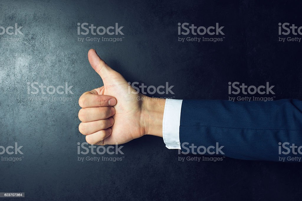 Like this. human hand with thumb up stock photo