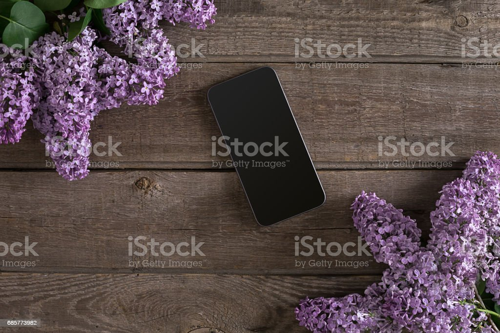 Lilac blossom on rustic wooden background, smart with empty space for greeting message. Top view royalty-free stock photo