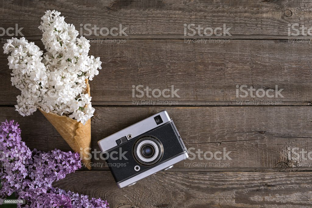 Lilac blossom on rustic wooden background with empty space for greeting message. Top view royalty-free stock photo