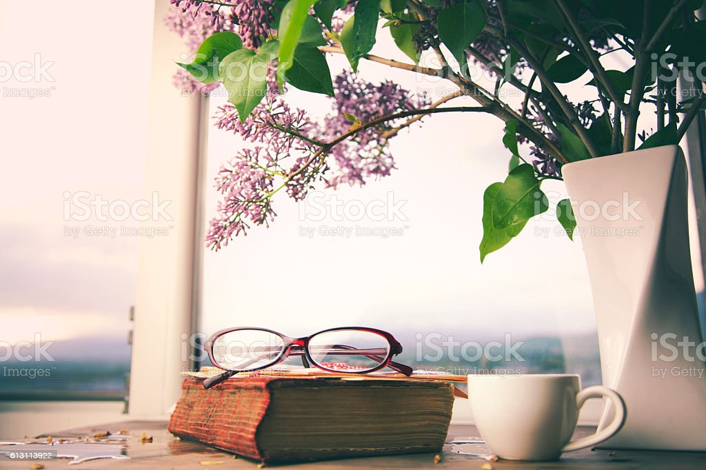 lilac, book and coffee  on table stock photo