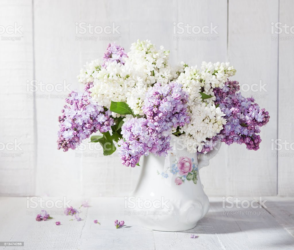 Lilac bouquet in ceramic jug. stock photo