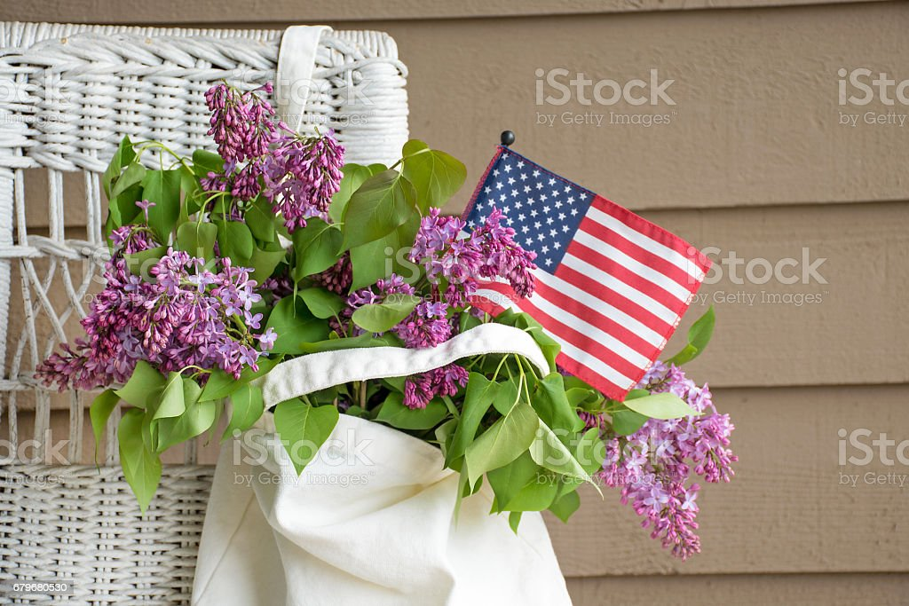lilac bouquet in sack with flag stock photo