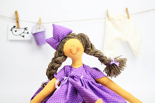 Lilac collector rag doll stock photo