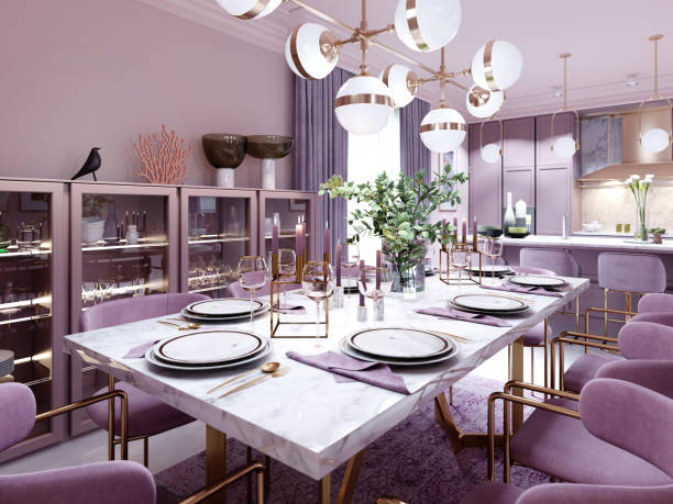 Lilac color dining room in trendy art deco style with modern furniture, served table and chairs.