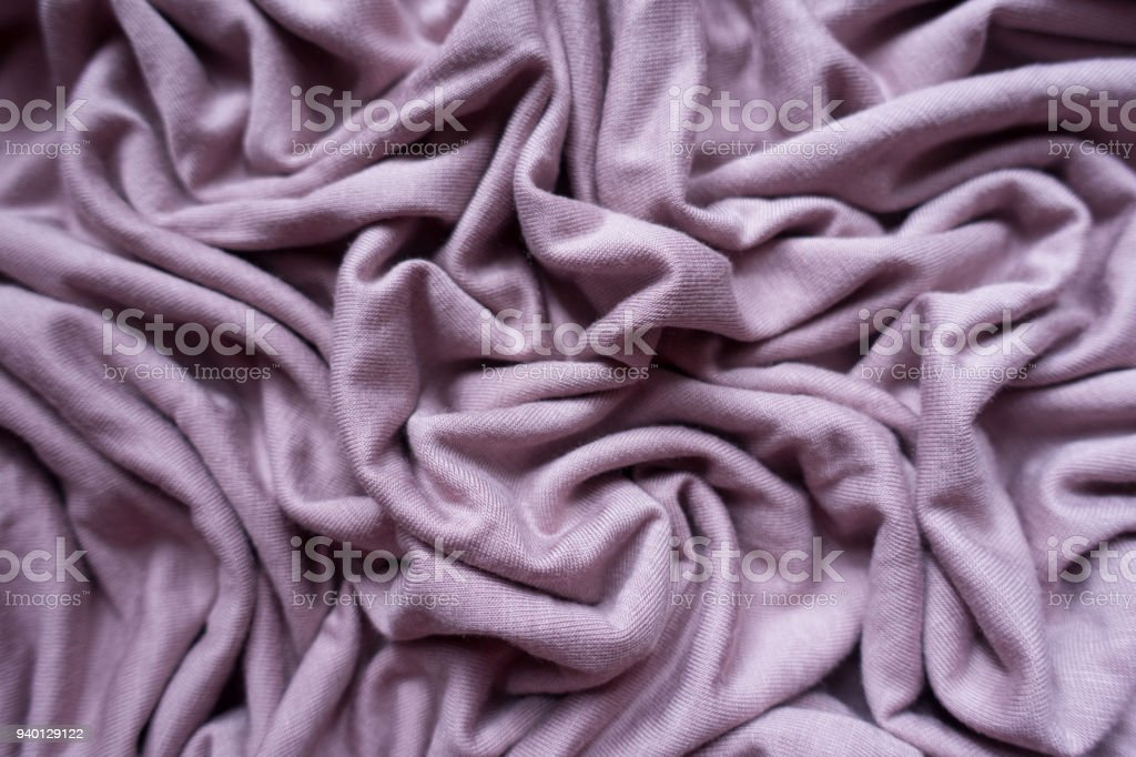 Lilac colored viscose fabric in soft folds from above stock photo