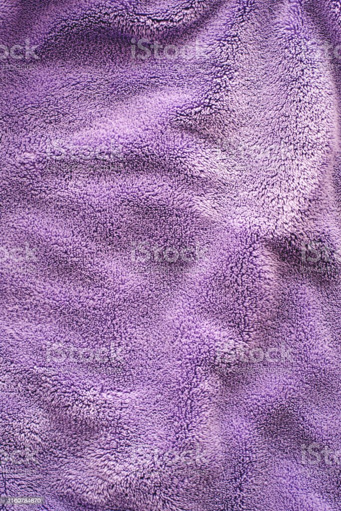 Lilac delicate soft background of fur plush smooth fabric. Texture of...