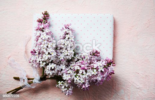 901386728 istock photo Lilac flowers arrangement with empty note card 950577226