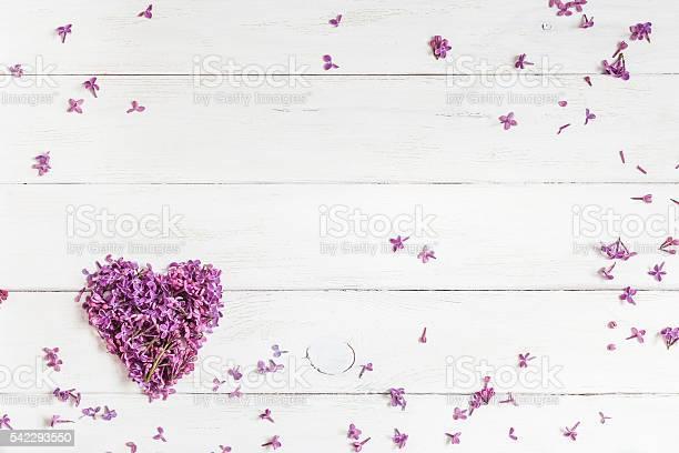 Lilac flowers in the shape of heart on wooden background picture id542293550?b=1&k=6&m=542293550&s=612x612&h=8ltaajm671l0onvno6d0qlhvb8iyhb2jaotn07uzdhi=