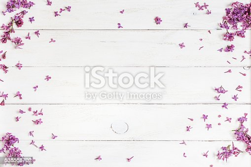 istock lilac flowers on white wooden background, top view, flat lay 538558702