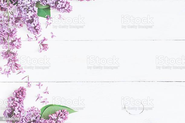 Lilac flowers on white wooden background top view flat lay picture id625844398?b=1&k=6&m=625844398&s=612x612&h=jejczndbxwr6phvhmpvjagq0bvpviijrl8hpqnobzzw=