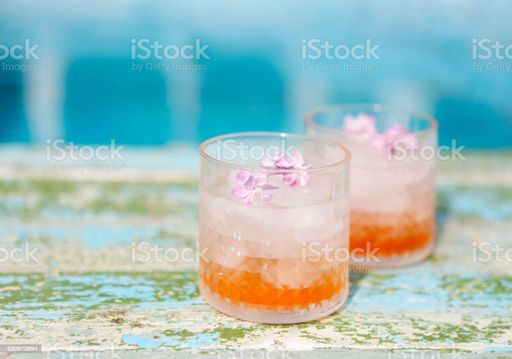 Lilac lemonade water with flowers stock photo