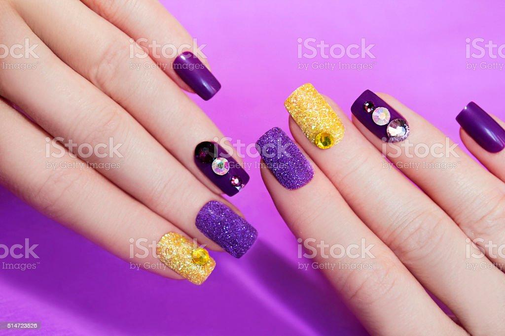 Lilac purple manicure. stock photo