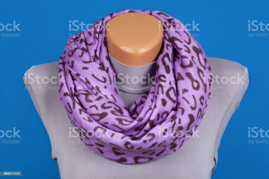 Lilac scarf on mannequin isolated on blue background. stock photo