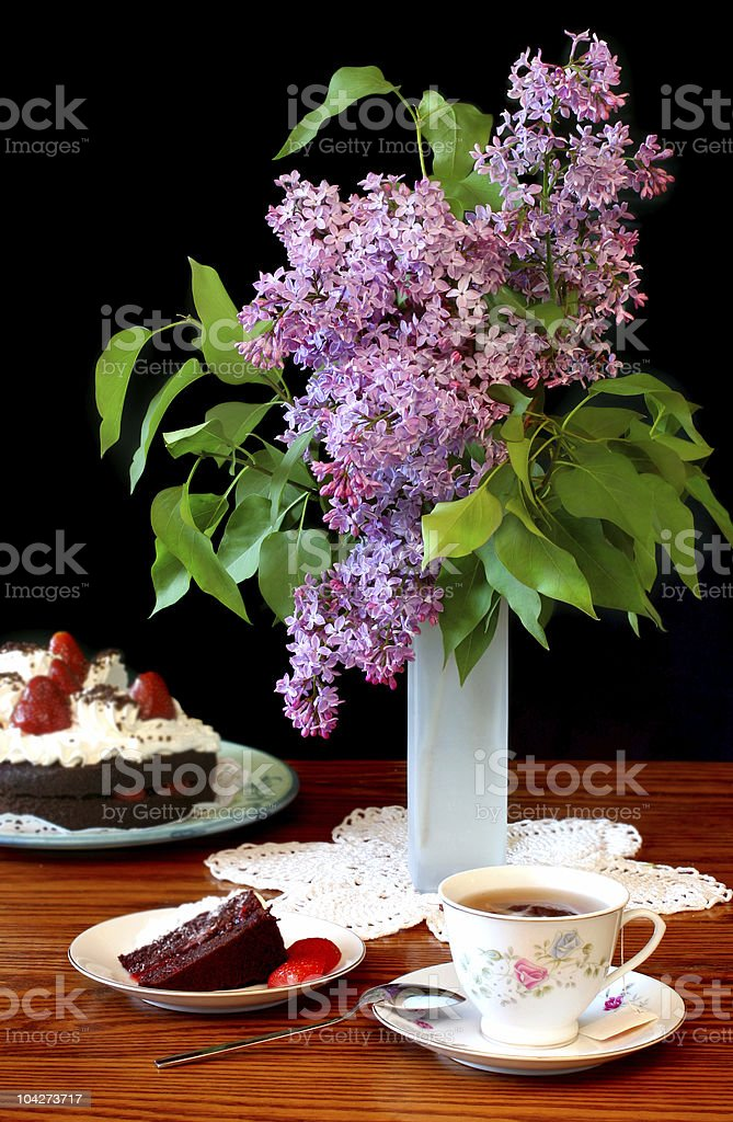Lilacs and cake royalty-free stock photo