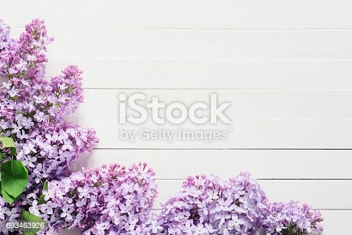 istock Lilacs flowers frame on white background 693463926