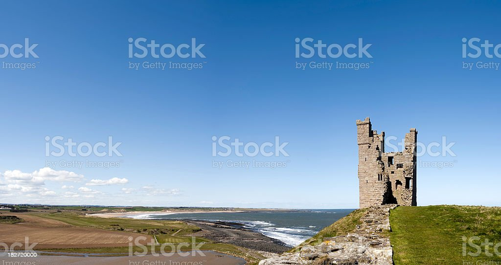 Lilburn Tower, Dunstanburgh Castle and Northumberland coastline panorama, UK stock photo