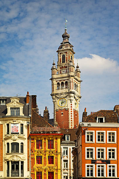 Lille Grand Place Lille, France - August 29, 2013: Lille Grand Place showing the Chambre of Commerce Clock tower centre fram and other Grand Place buildings in the foreground. picardy stock pictures, royalty-free photos & images