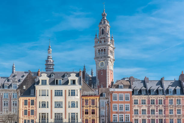 Lille, old facades in the center Lille, old facades in the center, the belfry of the Chambre de Commerce in background hauts de france stock pictures, royalty-free photos & images