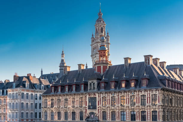 Lille, old facades Lille, old facades in the center, the belfry of the Chambre de Commerce in background hauts de france stock pictures, royalty-free photos & images
