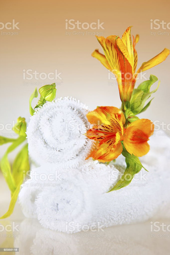 Lilly and towels royalty-free stock photo