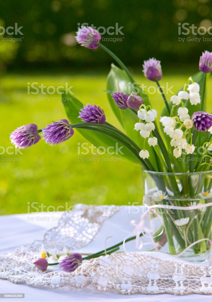 Lily of the valley bouquet in glas vase stock photo
