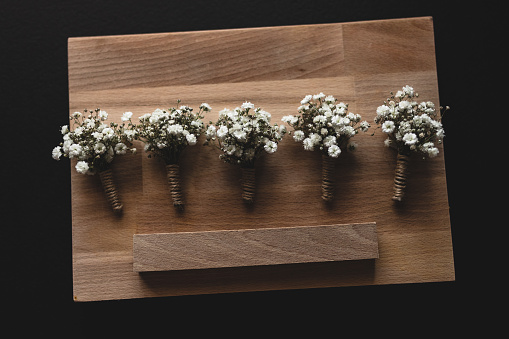 Lily of the Valley on old wooden background